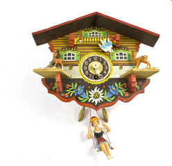 Vintage Cuckoo Clocks on White background