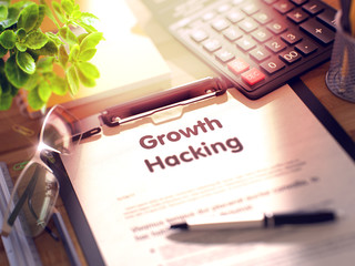 Growth Hacking. Business Concept on Clipboard. Composition with Clipboard, Calculator, Glasses, Green Flower and Office Supplies on Office Desk. 3d Rendering. Blurred Illustration.