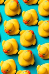 Yellow rubber ducks organized on blue background.