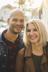 Portrait of loving couple smiling in city