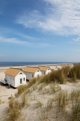 beach houses between the dunes and the sea