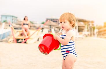 Hot tanned girl naked on beach