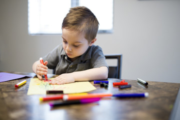 Young Boy Drawing on the kitchen table