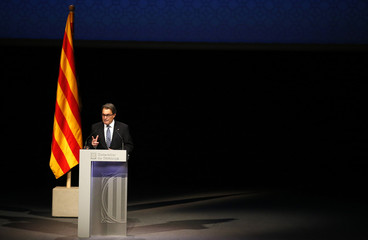 Catalonia's President Mas attends a conference in Barcelona, assessing the situation after a symbolic vote on the region's independence from Spain