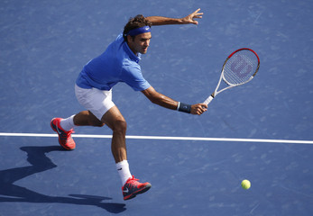 Federer of Switzerland returns to Berlocq of Argentina at the U.S. Open tennis championships in New York