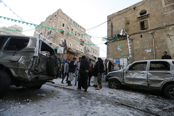 People gather at site of bomb explosion in Sanaa