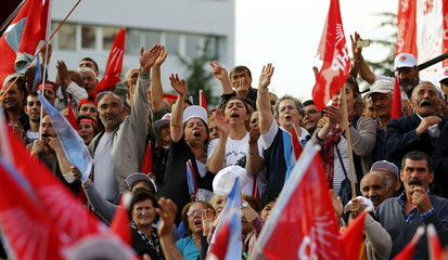 Supporters of Turkey's Republican People's Party leader Kilicdaroglu shout slogans and wave party flags during an election rally in Ankara