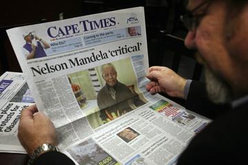 A man reads a newspaper in Cape Town