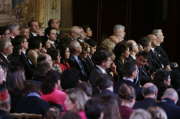 Members of the government attend French President Hollande's news conference at the Elysee Palace in Paris