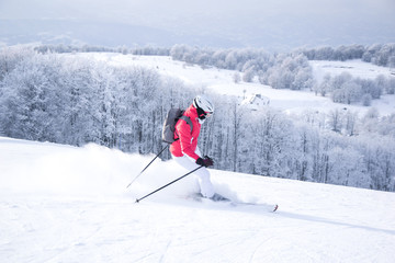 Woman skiing in mountain ski resort
