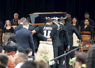 Former All Black Jonah Lomu's casket is carried into Eden Park for his memorial service in Auckland