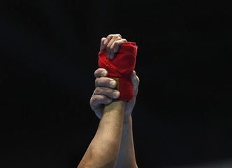 Referee holds up the hand of India's Thapa after he won his Men's Bantam Weight preliminary boxing bout by walkover during the 17th Asian Games in Incheon