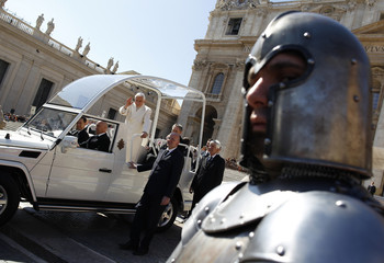 Man dressed up as Middle Age kings' guard stands as Pope Benedict XVI  leaves at end of his Wednesday general audience in Saint Peter's Square at the Vatican