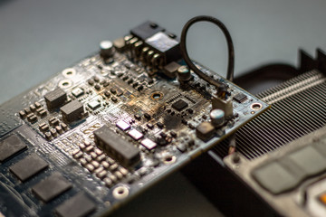 Disassambled and damage computer grafic card circuit board. Damaged by high temperature
