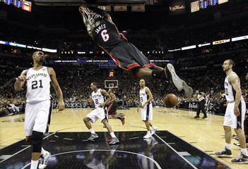 Miami Heat's LeBron James dunks for two-points during Game 5 of their NBA Finals basketball series in San Antonio