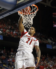 University of Louisville's Chane Behanan dunks the basketball over the North Carolina A&T's defense during the first half of their second round NCAA basketball game at the Rupp Arena in Lexington