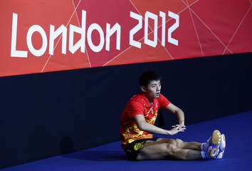 China's Zhang Jike stretches before his men's team gold medal table tennis singles match against South Korea's Joo Saehyuk at the ExCel venue during the London 2012 Olympic Games