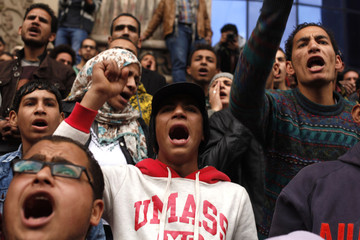Anti-government protesters chant slogans during a protest in front of the press syndicate in Cairo