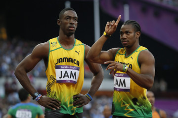 Jamaica's Yohan Blake and team mate Kemar Bailey-Cole react after winning their men's 4x100m relay round 1 heat during the London 2012 Olympic Games