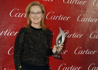 """Actress Meryl Streep, star of the film """"August: Osage County"""" poses backstage with her Icon Award at Palm Springs International Film Festival Awards Gala"""