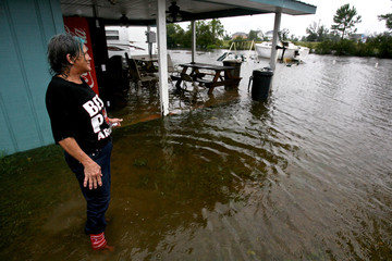 Debbie Shifter stands in the middle of a flooded trailer park in Bay St. Louis, Mississippi as Tropical Storm Lee slowly makes landfall