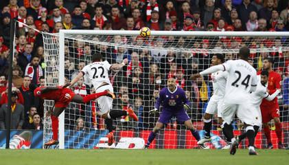 Liverpool's Sadio Mane scores their first goal