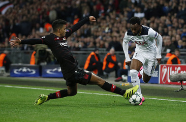 Tottenham's Georges-Kevin Nkoudou in action with Bayer Leverkusen's Wendell