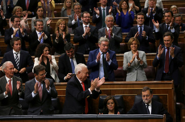 Newly re-elected Spanish PM Rajoy is applauded by fellow party deputies at Parliament in Madrid