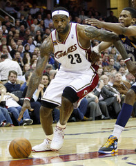 Cleveland Cavaliers LeBron James drives past Memphis Grizzlies Rudy Gay during the third quarter of their NBA basketball game in Cleveland