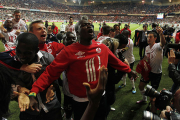 Lille's players celebrate winning the French championship after their Ligue 1 soccer match against Paris Saint Germain at the Parc des Princes stadium in Paris
