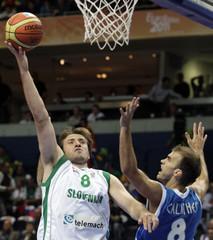 Smodis of Slovenia drives to the basket past Calathes of Greece during their FIBA EuroBasket 2011 basketball game in Vilnius