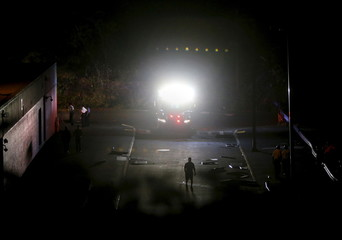 Members of the FDNY work outside after an explosion at John F. Kennedy High School in the Bronx borough of New York