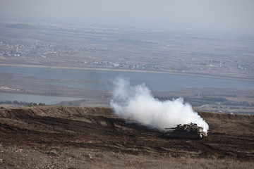An Israeli tank manoeuvres close to the ceasefire line between Israel and Syria on the Israeli-occupied Golan Heights