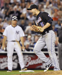 New York Mets third baseman David Wright reacts after he threw out New York Yankees batter Jorge Posada with the bases loaded in New York