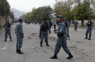 Afghan policemen secure an area near the site of a suicide bomb attack in Kabul