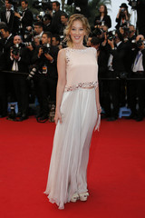 Actress Ludivine Sagnier poses on the red carpet as she arrives for the screening of the film 'The Great Gatsby' and for the opening ceremony of the 66th Cannes Film Festival in Cannes