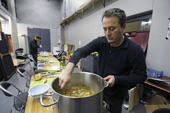 Austrian musician Jurgen Berlakovich, who is a member of the Vegetable Orchestra, cooks a soup from vegetables leftover from making musical instruments during the preparations for a concert in Haguenau, eastern France