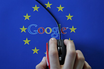 A woman hovers a mouse over the Google and European Union logos