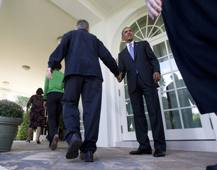 U.S. President Barack Obama shakes hands with Americans the White House says will benefit from the opening of health insurance marketplaces under the Affordable Care Act in the Rose Garden of the White House in Washington