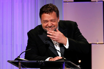 Actor Crowe mimics director Ridley Scott at the 30th annual American Cinematheque Award ceremony in Beverly Hills