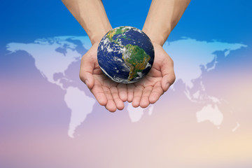 Two hands holding the earth on blurred map for safe and healing world concept.Elements of this image furnished by NASA.