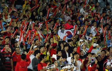South Korea's fans cheer during their Asian Cup semi-final soccer match against Iraq at the Stadium Australia in Sydney