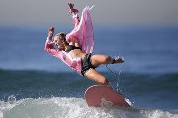 Competitor dressed as a boxer wipes out during the ZJ Boarding House Haunted Heats Halloween Surf Contest in Santa Monica
