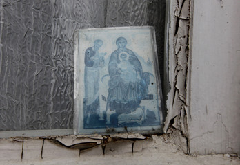 A copy of an icon lies against a window of the St Nicholas Church in Heybeliada island near Istanbul