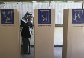 A resident votes at a polling station in Baghdad