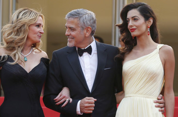 "Cast member Julia Roberts, George Clooney and his wife Amal pose on the red carpet as they arrive for the screening of the film ""Money Monster"" out of competition at the 69th Cannes Film Festival in Cannes"