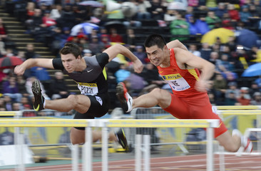 Pozzi of Britain and Xie of China compete in men's 110m hurdles heats during Diamond League London Grand Prix in London