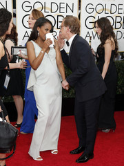 Kerry Washington and Christoph Waltz talk on the red carpet at the 71st annual Golden Globe Awards in Beverly Hills