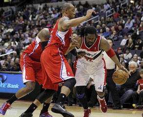 Washington Wizards forward Nene of Brazil dribbles against Los Angeles Clippers forward Butler during their NBA basketball game in Washington