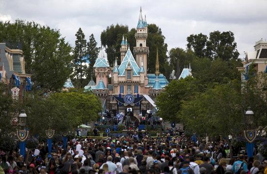 People are seen on the Main Street during Disneyland's Diamond Celebration in Anaheim